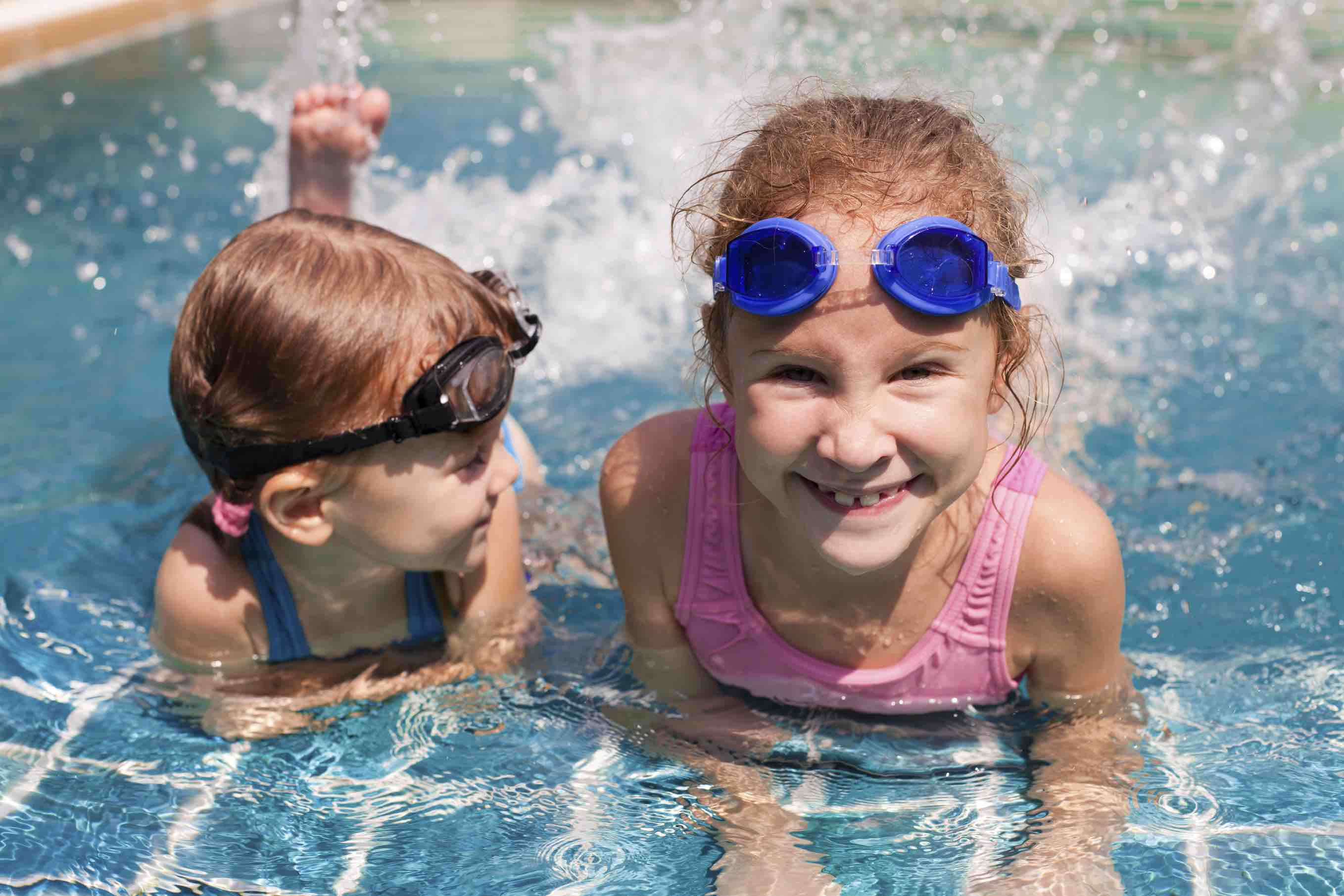 Chlorine might not be your teeth's best friend, but don't let pool chemicals prevent you from diving in!